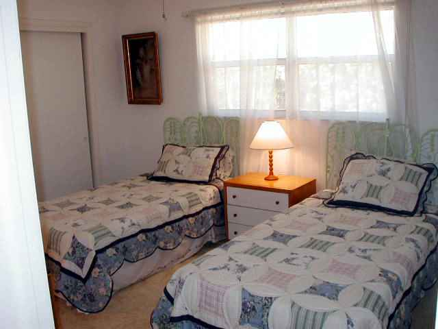The third bedroom has twin beds.